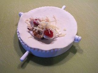 Gefüllte Blätterteigtaschen - Teig mit Füllung